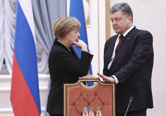German Chancellor Angela Merkel and Ukrainian President Petro Poroshenko during Minsk talks in Belarus, Feb. 11, 2015