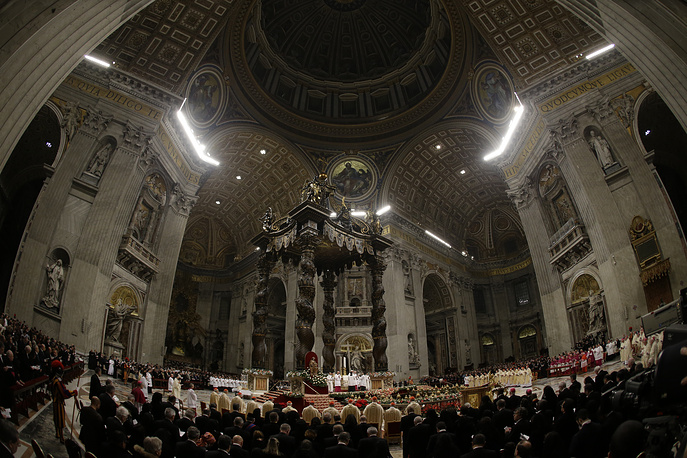 Pope Francis celebrating the Christmas Eve Mass in St. Peter's Basilica at the Vatican