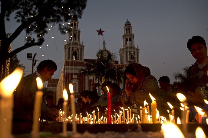 Indians lighting candles on the eve of Christmas at the Sacred Heart Cathedral in New Delhi