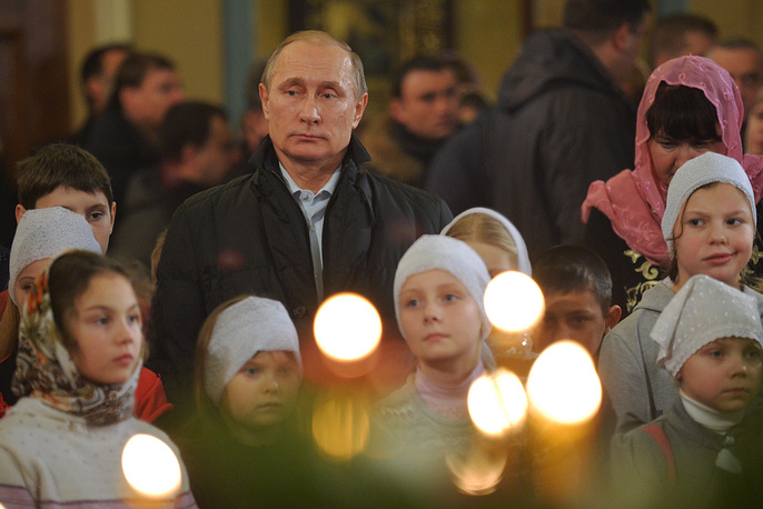Russian President Vladimir Putin at midnight Orthodox Christams Mass in a church in the village of Turginovo, Russia