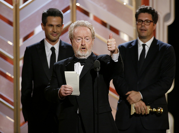 "Ridley Scott accepting the award for best motion picture comedy for ""The Martian"""