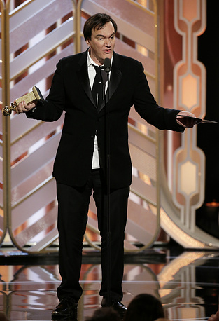 "Director Quentin Tarantino accepting the award for best original score on behalf of Ennio Morricone for the film, ""The Hateful Eight"""