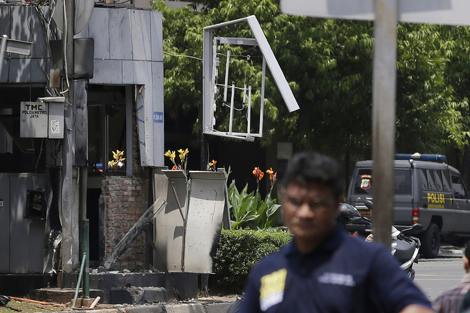 A police post in the center of Thamrin street across from Sarinah shopping mall damaged after a bombing in Jakarta