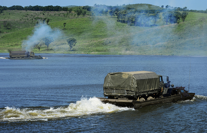 Amphibious cargo vehicles participating in military exercises conducted by the 5th Army's pontoon bridge units on organization and maintenance of assault troop and bridge crossings in Primorye territory