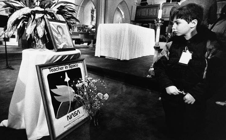 Shrine set up in memory of Christa McAuliffe at St. John's Church in Concord, New Hampshire, January 30, 1986, following a memorial service. The Challenger's crew was honored with burials at Arlington National Cemetery