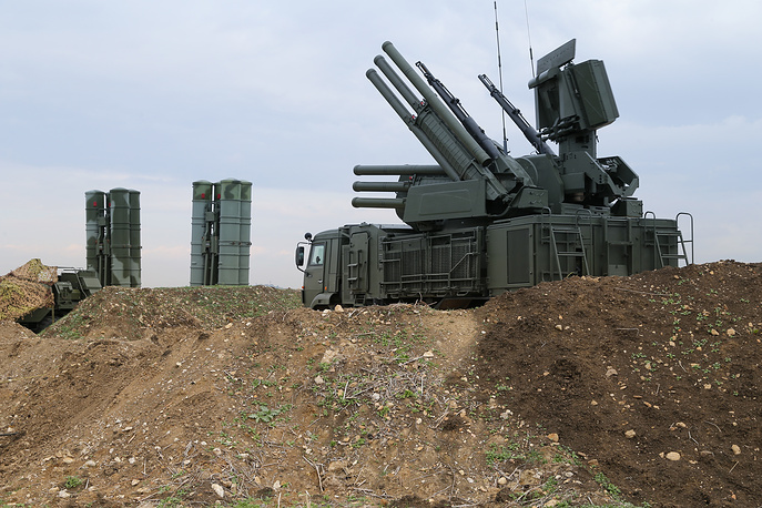 Russian Pantsyr-S1 air defense weapon system, foreground, and the S-400 long-range air defense missile systems in Syria