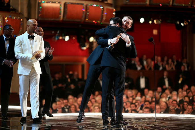 Singer Sam Smith and songwriter Jimmy Napes accepting the award for Best Original Song