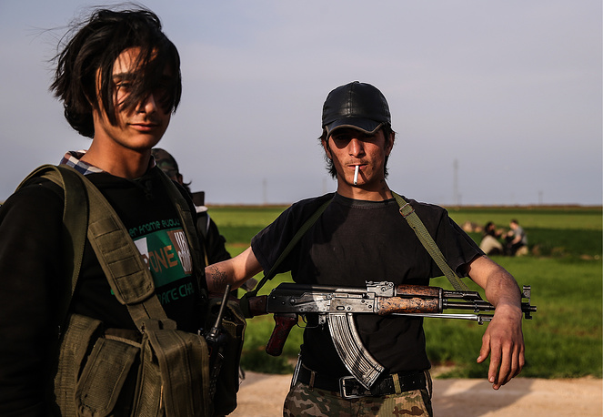 Soldiers of Jaysh al-Thuwar, or the Army of Revolutionaries, an armed rebel group allied with YPG and taking part in the Syrian Civil War,near the town of Azaz