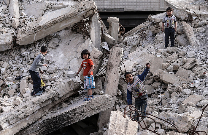 Children in a Damascus neighborhood, an area liberated when a ceasefire agreement between the Syrian Army and the rebels controlling the district came into effect on February 27, 2016