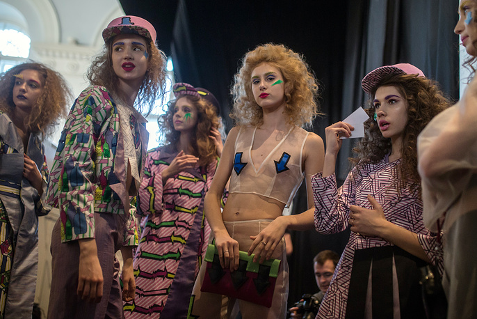 Models backstage as they prepare to display creations by Contradiction Fashion group during Mercedes-Benz Fashion Week in Moscow