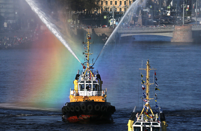Tug boats dancing on the Neva River during the 3rd Icebreaker festival in Saint Petersburg