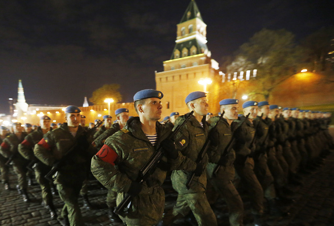 Russians servicemen marching in Moscow's Red Square during a night rehearsal of the upcoming 9 May military parade
