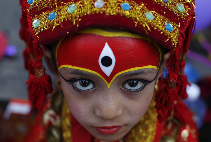 A Nepalese girl wearing traditional attire at the Kumari Puja, a baby girl mass worship ceremony in Kathmandu, Nepal, September 14