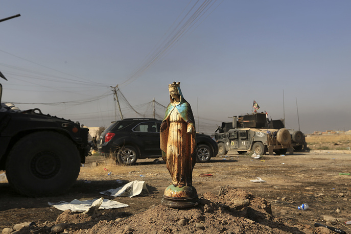 A statue of Virgin Mary in Bartella, outside Mosul, that was captured by Iraqi forces