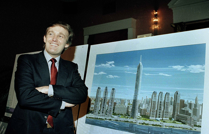 Donald Trump displays an artist's concept of a vast complex called Television City in New York, 1985