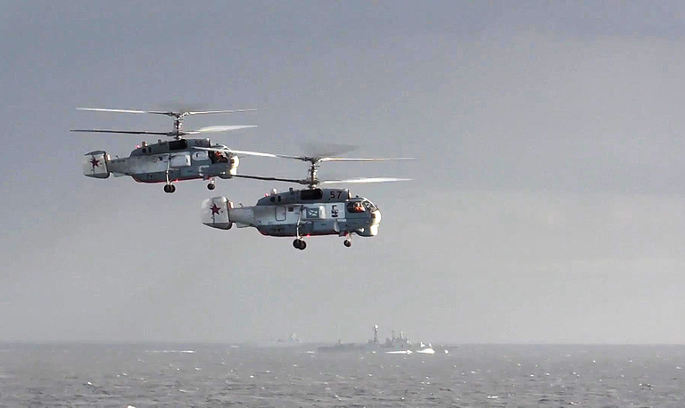 Russian helicopters and the Admiral Kuznetsov flagship aircraft carrier in Syria