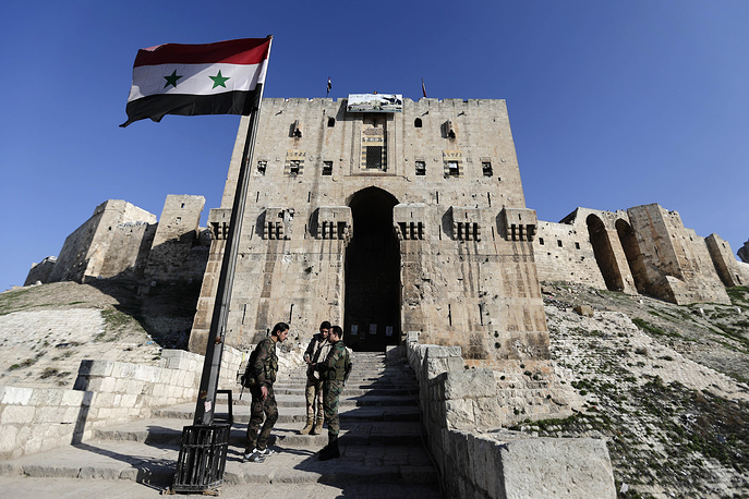 During the conflict, the walls of Citadel were used as cover while shelling surrounding areas and ancient arrow slits in walls were used by snipers to target rebels. Photo: The main gate of the ancient Aleppo Citadel