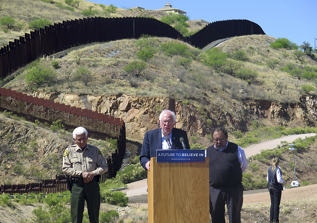 Former Democratic presidential candidate Bernie Sanders speaking near the border fence that divides Arizona and Mexico, in Nogales, USA