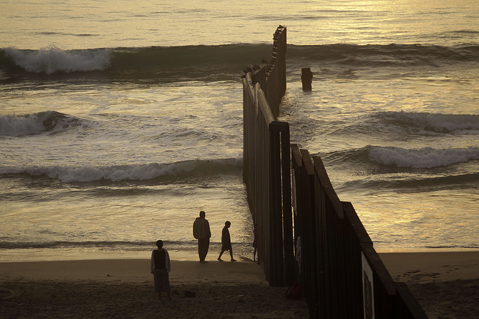 This section is the western end of a wall separating Tijuana from San Diego runs through the beach before ending in the Pacific Ocean