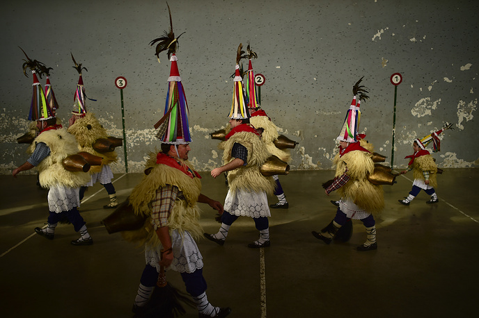 Bell carrying people called Joaldunaks take part in carnival between the Pyrenees villages of Ituren and Zubieta, northern Spain, January 30