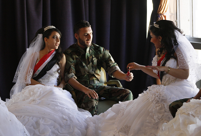 Brides and bridegrooms preparing themselves for mass wedding being held in the Dama Rose Hotel in Damascus, Syria, February 6