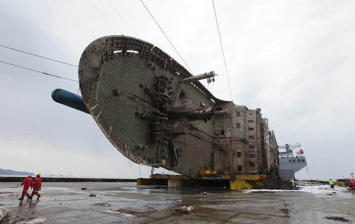 The sunken ferry Sewol on a semi-submersible transport vessel seen during the salvage operation in waters off Jindo, South Korea, March 26