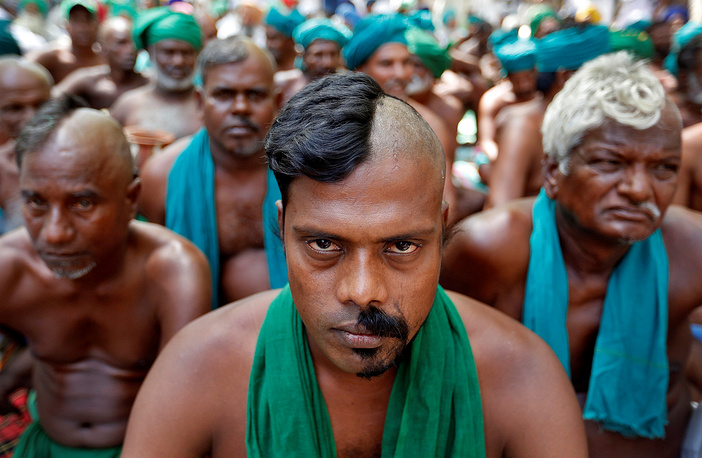 Farmers from the southern state of Tamil Nadu pose half shaved during a protest demanding a drought-relief package from the federal government, in New Delhi, India, April 3