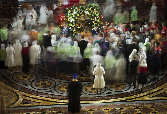 Russian Orthodox believers gather to kiss the relics of Saint Nicholas in the Christ the Savior Cathedral in Moscow, Russia, May 21