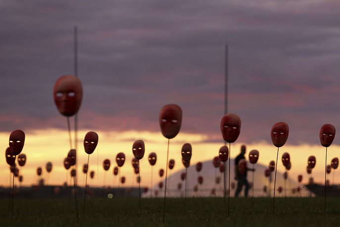 Masks representing corrupt politicians line the lawn outside the National Congress building, in Brasilia, Brazil, May 23