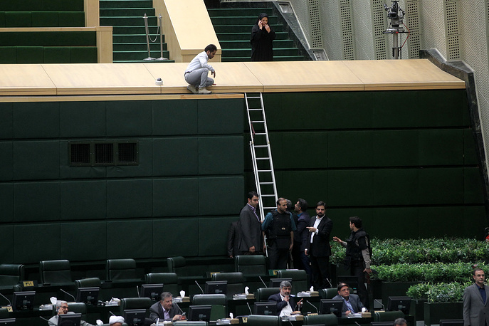 Iranian policemen deployed inside the parliament building to protect Iranian lawmakers during an attack in Tehran