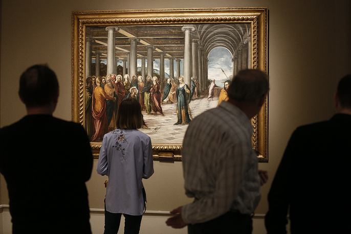 Visitors view Christ and the Woman Taken in Adultery by Tintoretto dating from the 16th century