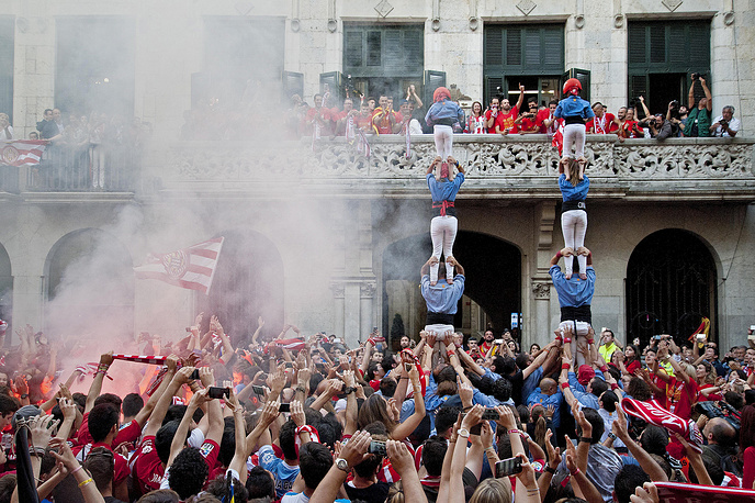 Girona FC's supporters celebrate their team's promotion to the Spnaish Primera Division from the balcony of the City Council of Girona, Spain, June 5