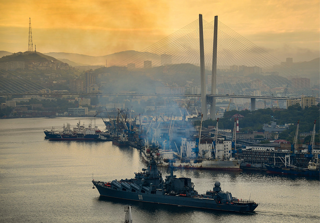The flagship of the Russian Navy's Pacific Fleet, Varyag missile cruiser, enters the Golden Horn Bay in Vladivostok after a two-and-a-half-month long distance voyage, Russia, June 14