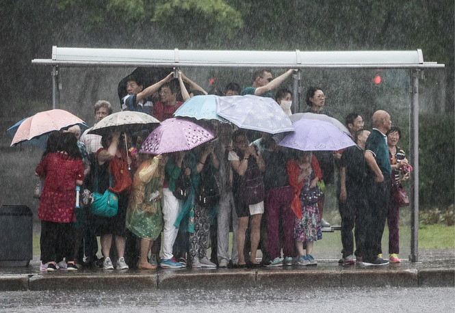 Tourists seen during a storm on Moscow's Sparrow Hills