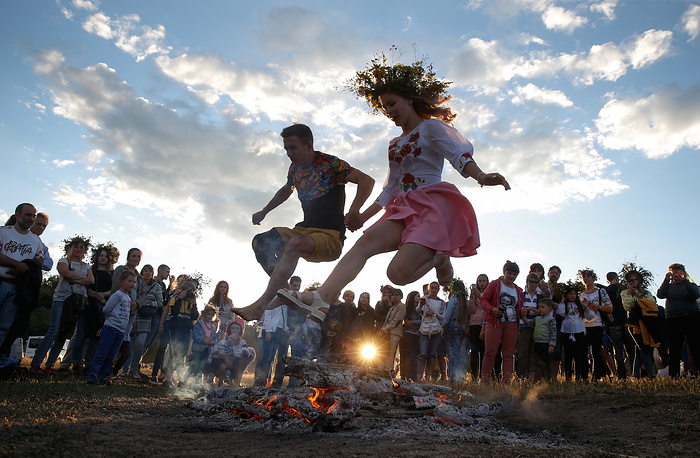 Ukrainians jump over a fire in Kiev as they celebrate the traditional pagan holiday of Ivana Kupala, Ukraine, July 6