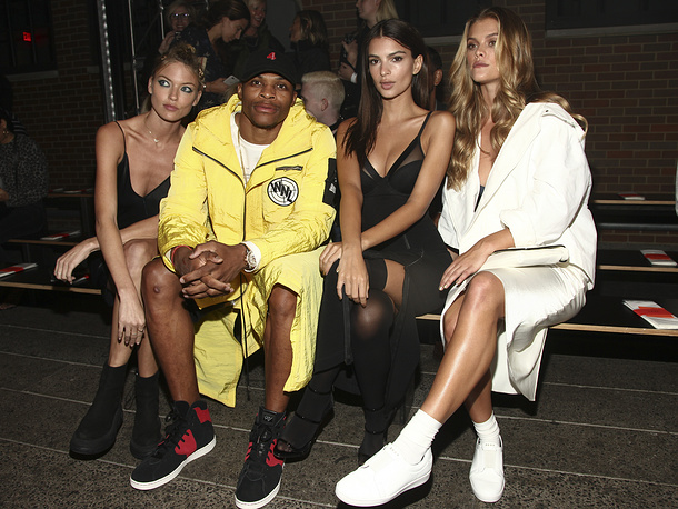Basketball player for the Oklahoma City Thunder Russell Westbrook was crowned Fashion King for 2017. Photo: Martha Hunt, Russell Westbrook, Emily Ratajkowski and Nina Agdal at the DKNY fashion show, 2016, in New York