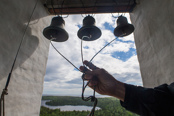 A monk rings bells at the Golgotha-Crucifixion Skete