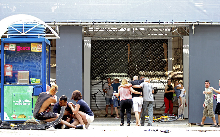 Injured people react after a van crashed into pedestrians in Las Ramblas, Barcelona, Spain, August 17