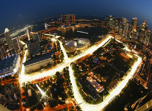 The illuminated Marina Bay Street Circuit race track and skyline of Singapore during the sunset time, Singapore, September 14