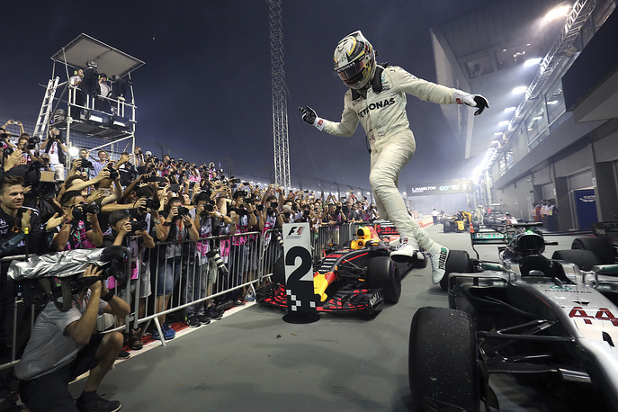 Mercedes driver Lewis Hamilton of Britain celebrates after winning the Singapore Formula One Grand Prix on the Marina Bay City Circuit Singapore, September 17