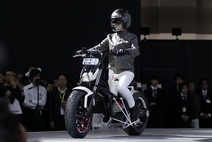A model demonstrates Honda Motor Co.'s Honda Riding Assist-e