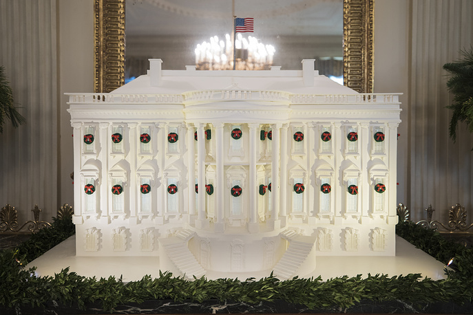 A gingerbread replica of the White House in the East Room