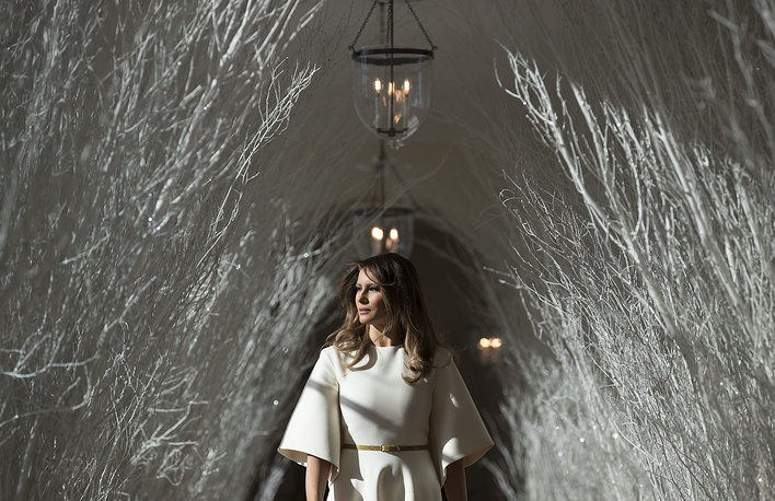 "US First lady Melania Trump walks along the East Colonnade decorated in white branches that are part of 2017 holiday decorations with the theme ""Time-Honored Traditions"" at the White House in Washington, USA, November 27"