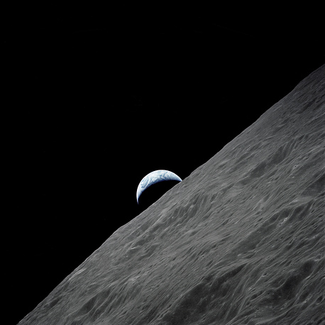 The crescent Earth rises above the lunar horizon as seen from the Apollo 17 spacecraft