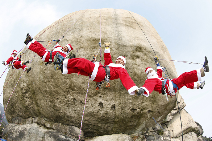 South Korean rock climbers wearing Santa Claus costumes seen at an event in the Christmas holiday season on the Bulam mountain in Seoul, South Korea, December 3