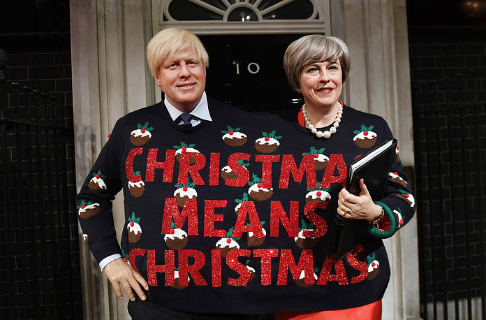 Madame Tussaud's wax figures of British Prime Minister Theresa May and British Foreign Secretary Boris Johnson wearing a Christmas Jumper at Madame Tussauds in London, Britain, December