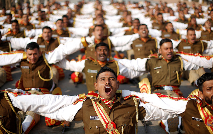Indian soldiers take part in a laughter yoga session during their rehearsal for the Republic Day parade on a winter morning in New Delhi, India, January 11