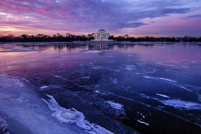 The Jefferson Memorial is reflected in the frozen surface of the Tidal Basin at daybreak in Washington, January 8