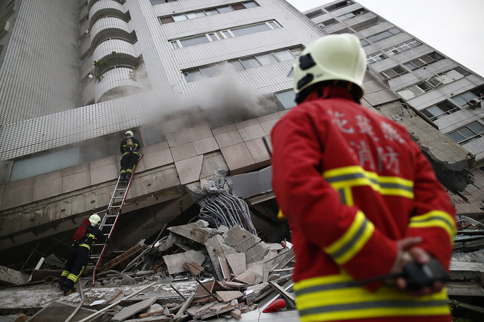 Rescue services work outside a damaged building in Hualien