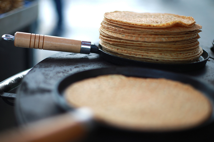 Making Russian pancakes during a celebration of Maslenitsa festival in central Vladimir